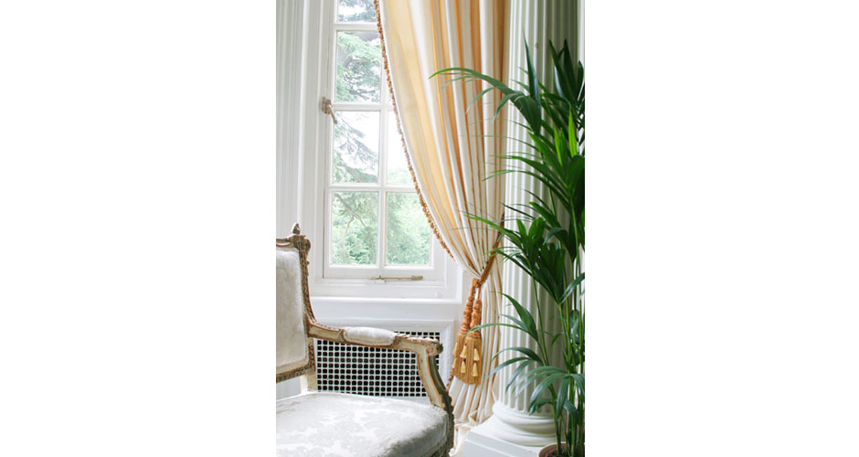 luxury interior with gold chairs and curtain ties