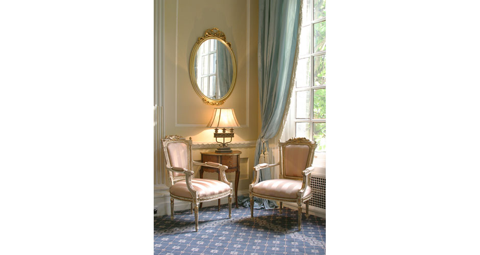 luxury interior with gold chairs and curtain ties and blue carpet