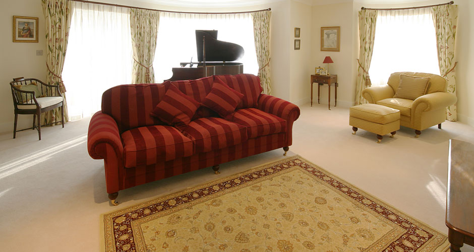 Red sofa in yellow room