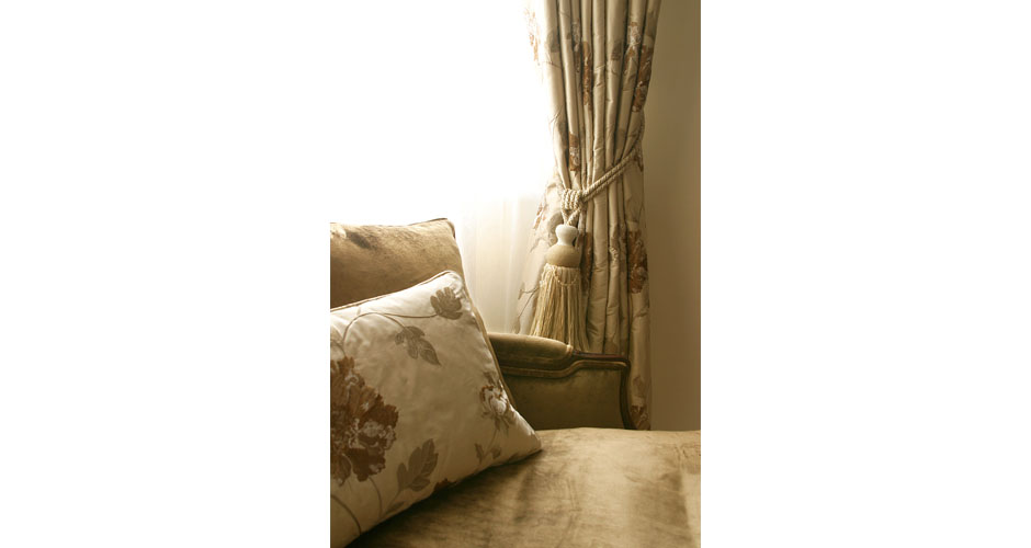 Gold cushion and gold curtains
